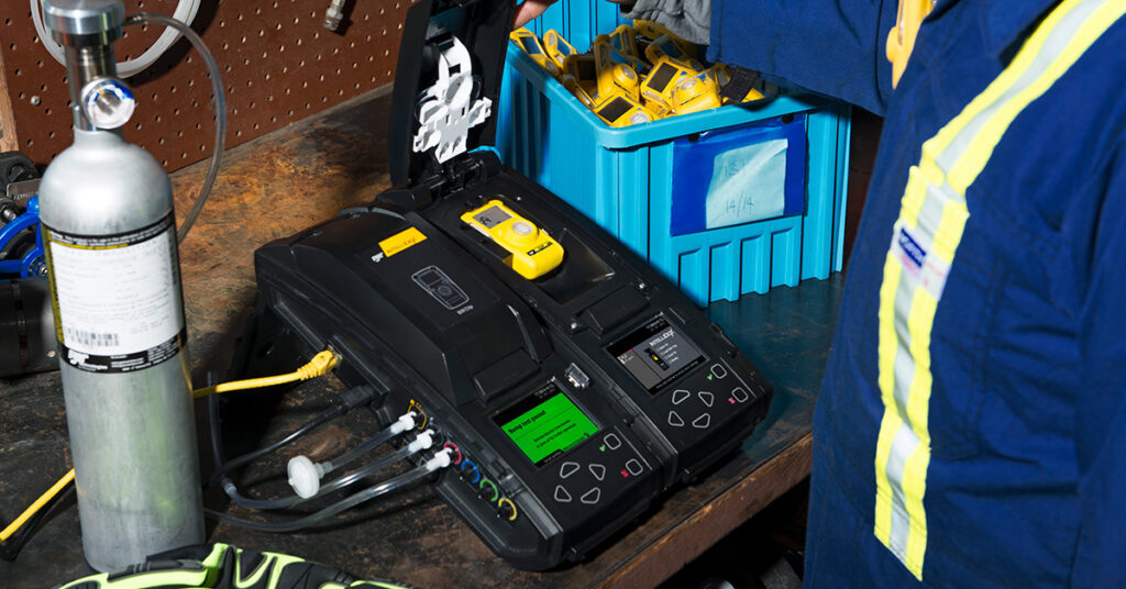 Engineer using MicroDocK II Calibration Station to bump test the BW Clip gas detector